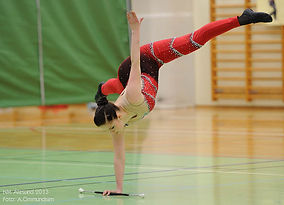 Norwegian baton twirler doing a handstand. Sportsdrill.