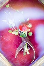 wedding on a ranch,wedding photo shoot,wedding centerpiece,wedding reception,wedding table setup,wedding red and gold theme,wedding red roses,wedding equestrian theme,wedding horse shoe accents,wedding dress,wedding outside,wedding cake,wedding hair