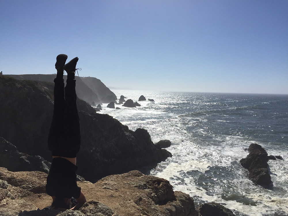 Headstand and ocean