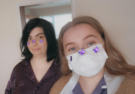 Carer and client posing for a selfie with purple butterflies on their faces