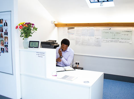 Care Manager taking a call from a client at 4Life Healthcare Services' Head Office reception