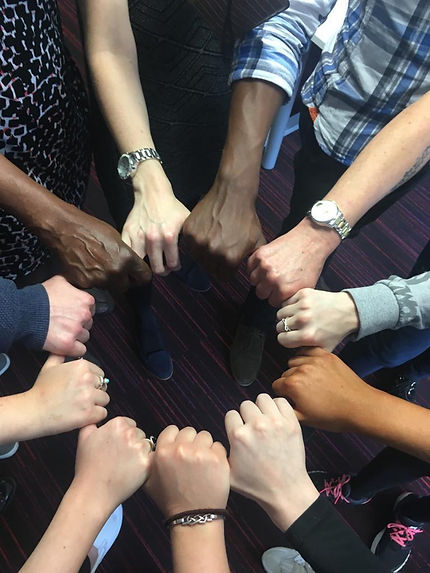 Carers from diverse backgrounds united in a circle