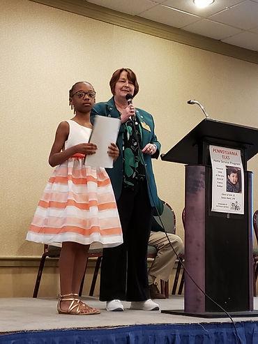 Makaylah Brown accepting her award - Elk