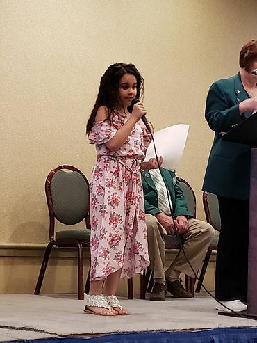Anushka Kumar accepting her award - Elks