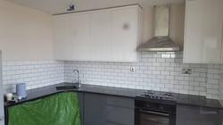 Tiling kitchen splash back, Hackney