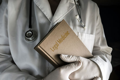 Doctor holding Law book image