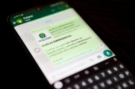 640 mil beneficiários do auxílio de R$ 600 podem desbloquear o dinheiro no WhatsApp