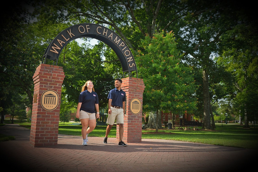 Two METP students at the Walk of Champions in the University of Mississippi Grove