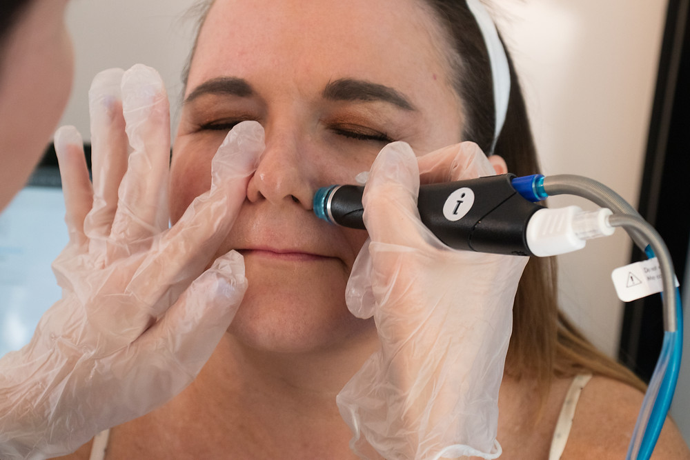 Woman getting HydraFacial at A New Dawn Wellness Center in Scottsdale, AZ