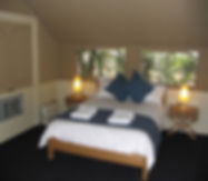 A Safari Cabin interior with double bed at Carnarvon Gorge Wilderness Lodge.