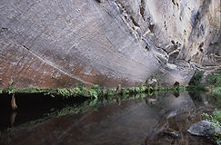 Cliffs curve over still water at Big Bend, Carnarvon Gorge.
