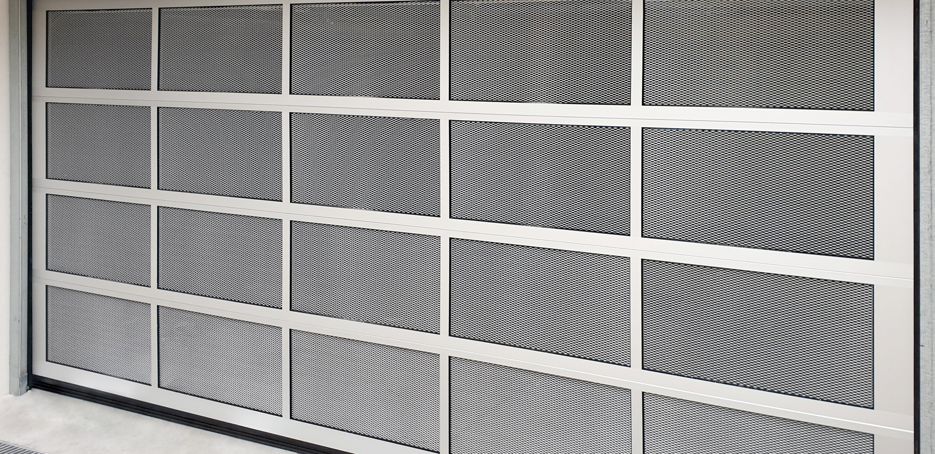 Perforated sectional door