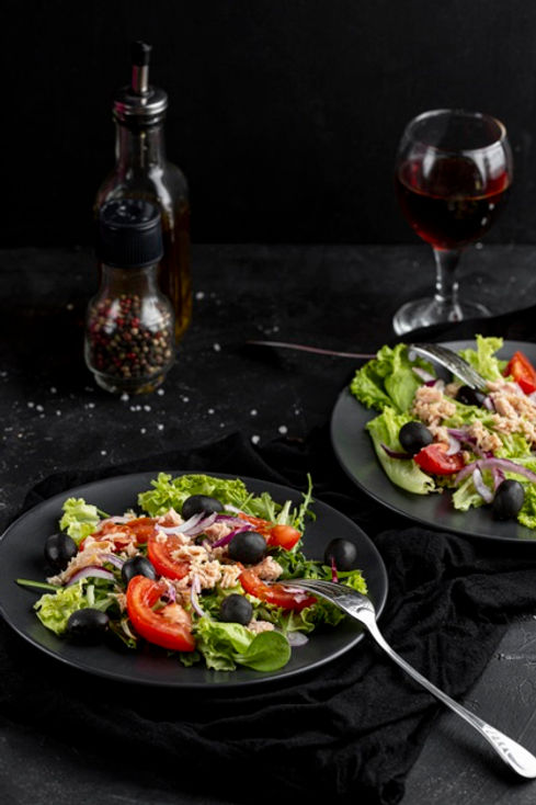 homemade-salad-dark-plate_23-2148537158.