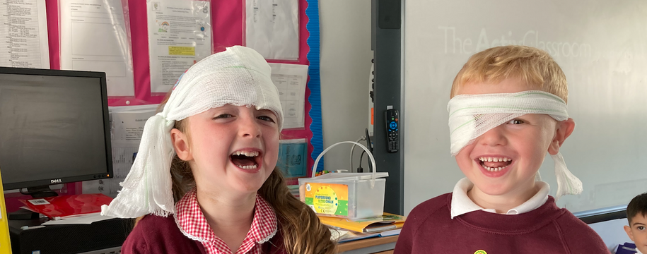 The happiest injured people! We have been learning to wrap bandages.