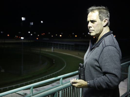 Clocker Gary Young timed the horses during training from the fifth floor of Churchill Downs. May 3, 2016. (Photo: By Pat McDonogh, The CJ)
