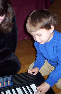 web #11 Mrs G Clef teaching piano to the