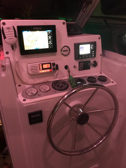 control panel of 24ft rampage in panama for charter