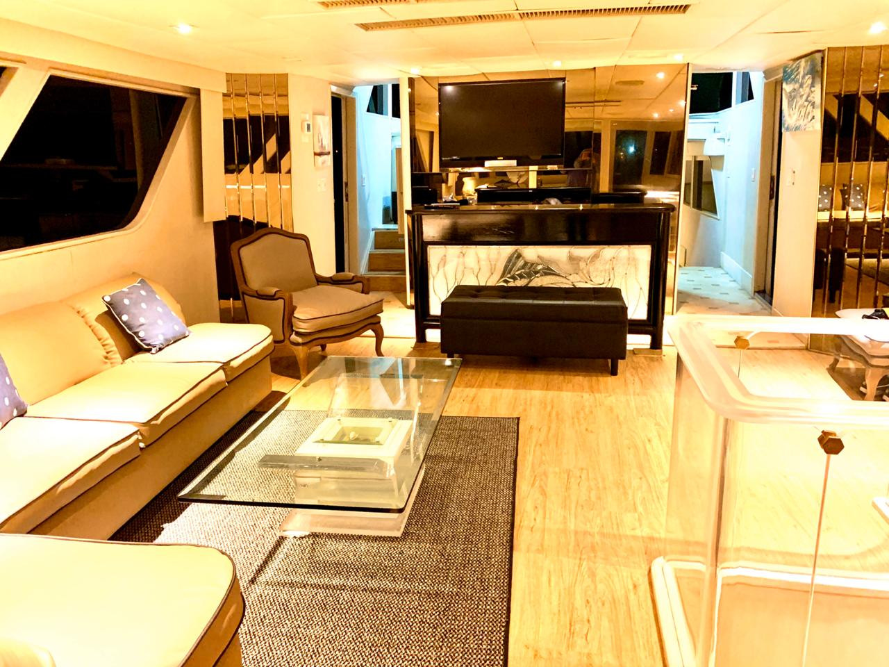 living room of 90ft broward yacht for charter in panama