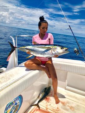 beautiful girl in panama fishing caught a tuna