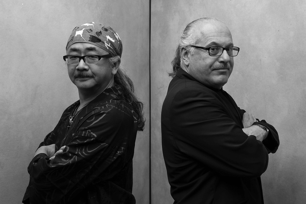Nobuo Uematsu on the left. Arnie Roth on the right.