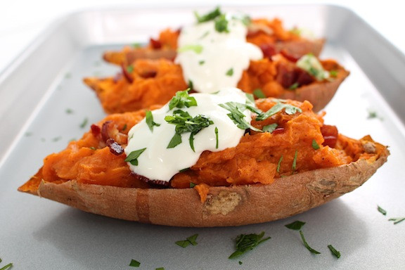 Baked potatoes with bacon and sour cream