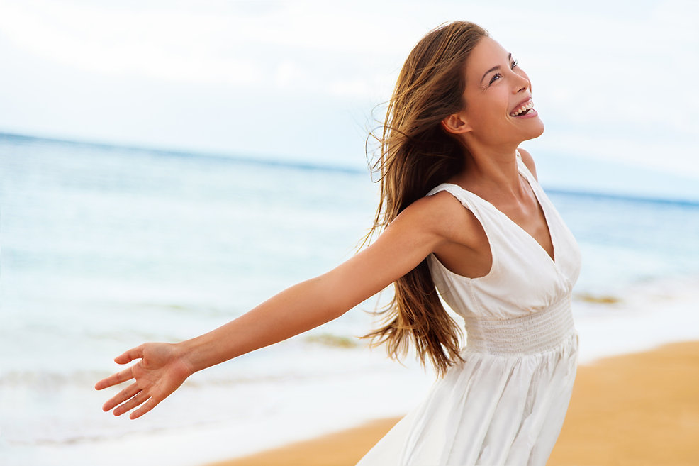Free happy woman on beach enjoying natur