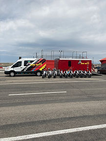 line of pocket rockets in front of minimoto van and trailer