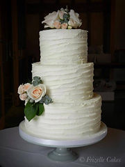 Textured buttercream cake by Frizelle Cakes Chichester. Southend Barns Wedding Cake