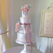 Pink wedding cake with lustre chichester