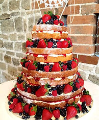 Naked Cake with fresh fruits by Frizelle Cakes Chichester at Bartholomew Barn