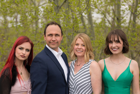Family Photographs in Calgary Park after Graduation