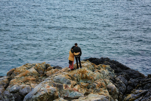 couple looking out at the pacific ocean