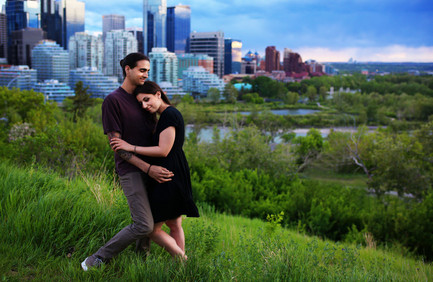 A man and woman overlooking the city