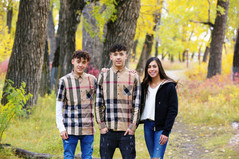 Three teenagers in the park getting their photo taken