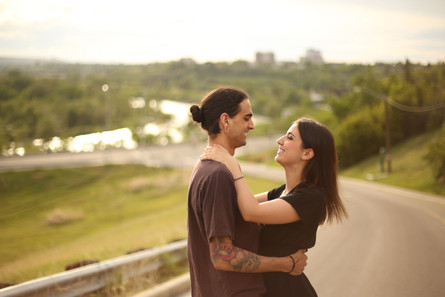 A man and woman hugging on a road