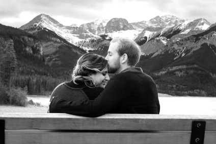 Couple on a bench in the mountains
