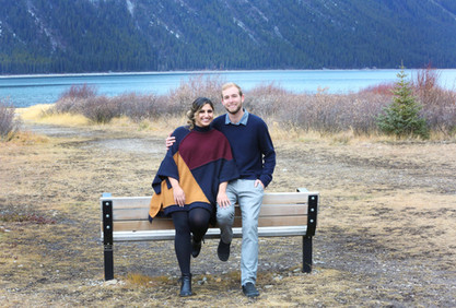 Couple leaning on a bench in the mountains
