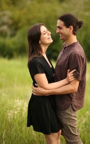 A man tickling a woman
