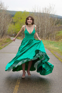 Graduate spinning in puffy dress at Glenmore Park