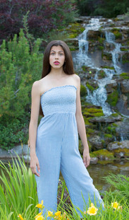Model standing by Waterfall