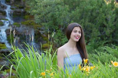 Smiling model near waterfall