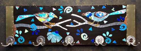 two blue birds on 5 hook coatrack made from upcycled tins