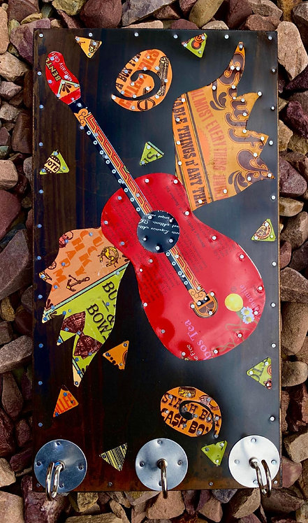 funky winged guitar key holder made from salvaged metal tins