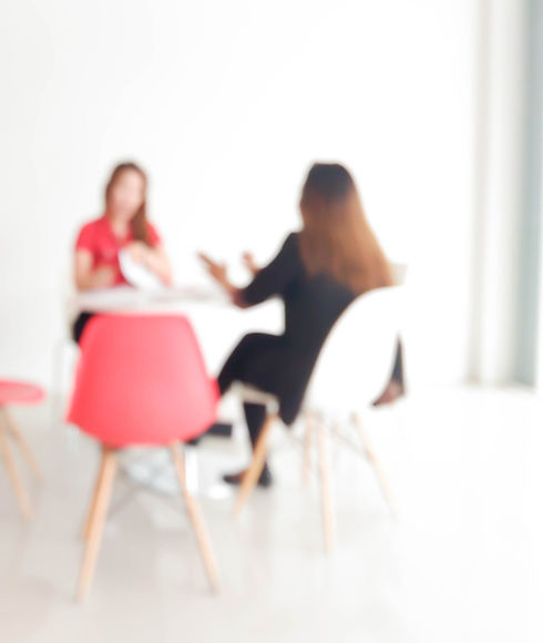 blur of two 20s-30s woman talking in modern office _ for background use_edited.jpg