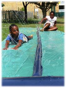 Josh & Zviki - racing down the slide