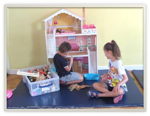 Siblings Busy Playing Barbie