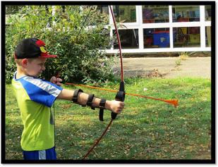 Riley - practicing his Archery