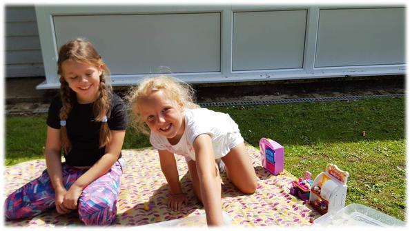 Holly & Amber - enjoying Shopkins outside