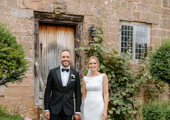 bride and Groom Outside the Dovecote