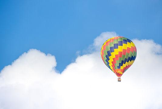 yellow-blue-and-green-hot-air-balloon-fl